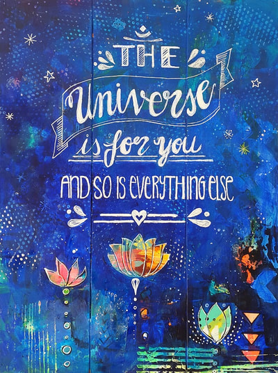 blue painting on wood pannel with the quote The Universe Is For You And So Is Everything Else